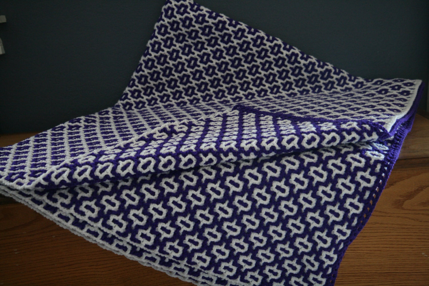 Purple and white reversible crochet afghan