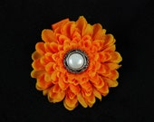 Orange flower clip w/pearl center