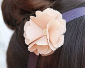 soft peach fabric flower on purple headband