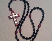 Beautiful Rosary made with glass beads and a Rich Colored Magnesite Cross.