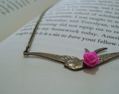 Swallow charm necklace, finished with a fuchsia cabochon