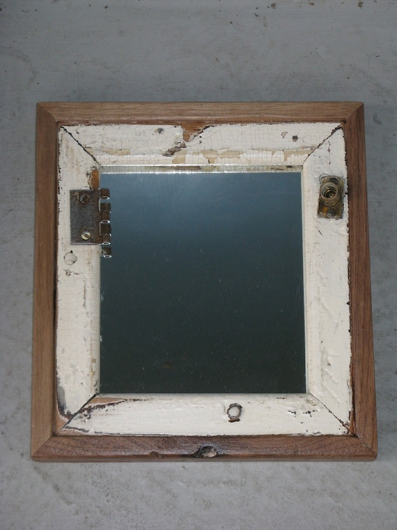 Mirror with reclaimed wood frame, antique white paint, and original metal hinges