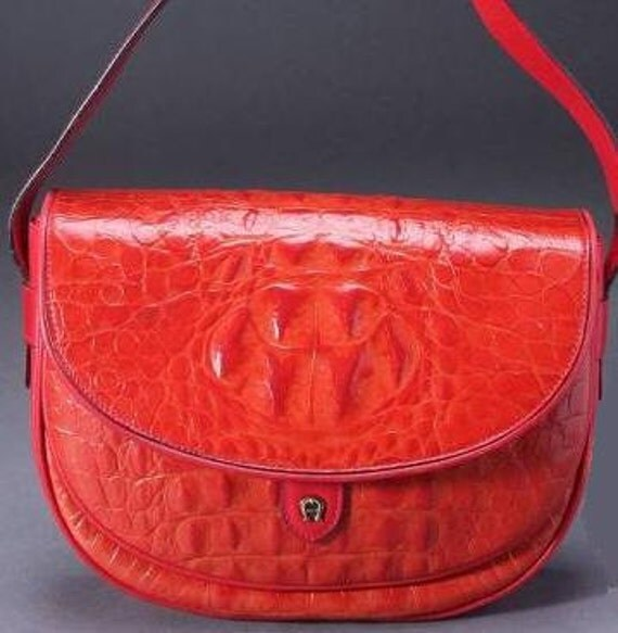90s Vintage Etienne Aigner arigator embossed leather shoulder purse. Stunning color of deep orange