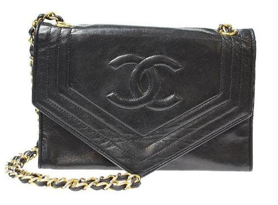 80s CHANEL black envelop flap lambskin purse with gold tone chain strap.