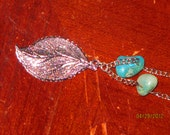 Necklace with silver leaf charm and turquoise blue and green stones