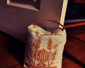 Flour sack door stop