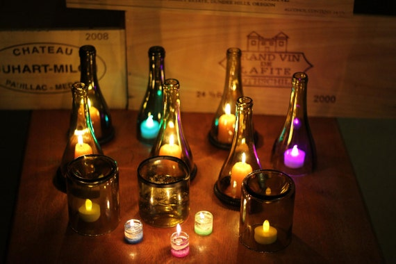 A set of 3 wine bottle candles