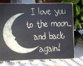 """Hand painted wooden black primitive sign. """"I love you to the moon... and back again."""""""