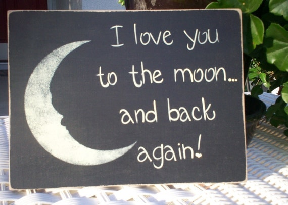 "Hand painted wooden black primitive sign. ""I love you to the moon... and back again."""