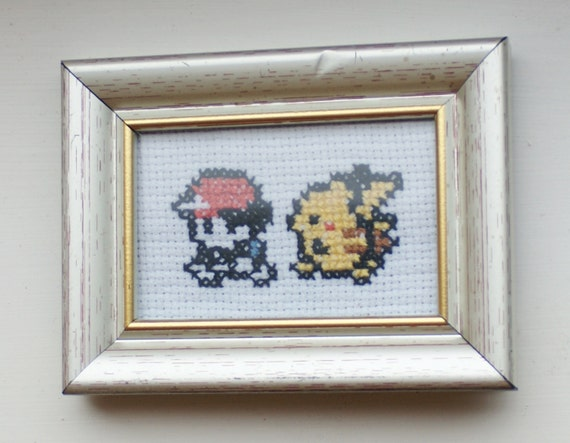 Trainer and Pikachu: Pokemon-inspired mini cross stitch in a vintage frame - pixel art, retro gameboy image