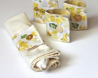 fabric napkin rings // vintage daisy fabric // yellow tabletop decor // upcycled decor // daisy home decor // button napkin rings