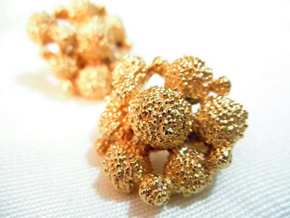Vintage gold metal cluster clip on earrings by D'Orlan