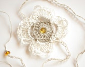 Elegant crochet linen headband decorated with baltic amber