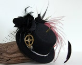 SUMMER SALE....Black mini top hat fascinator with cogs and feathers inspired by the steam punk movement