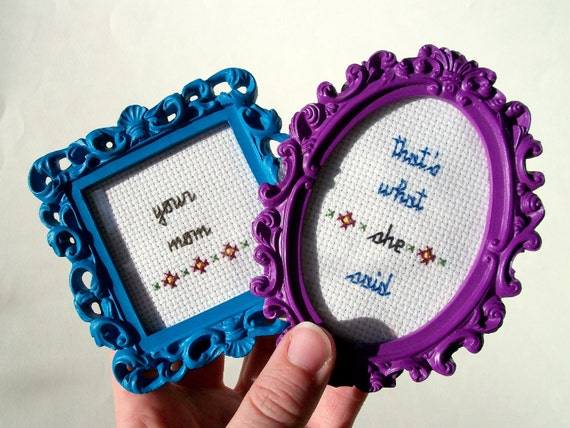 That's What She Said -- Your Mom mini set of funny framed cross stitches in purple frame and blue square frame