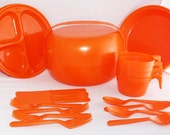 Vintage orange plastic picnic set in space age container- look great in VW campervan