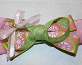 pink and green floral bow on clip