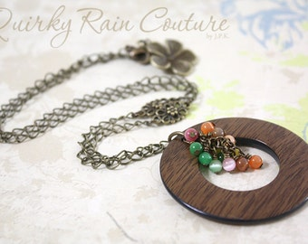 Floral Woodland - antique bronze necklace with large wooden hoop pendant, cluster of cat's eyes and floral accents