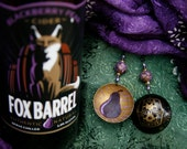 Upcycled Fox Barrel Cider Company domed botle cap earrings with hand-painted beads and backs