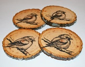 hand painted natural wood coasters in a beautiful and earthy bird design