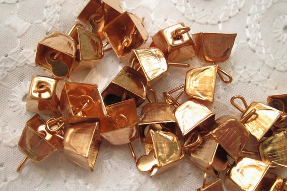 """Thirty-Three Tiny Copper Cow Bells for your Crafts Projects.  About 1/4"""" in height and 3/8"""" across - Reserved for """"C"""""""