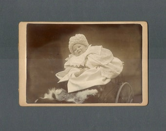Amusing Cabinet Card of a Baby Tipping Out of a Carriage