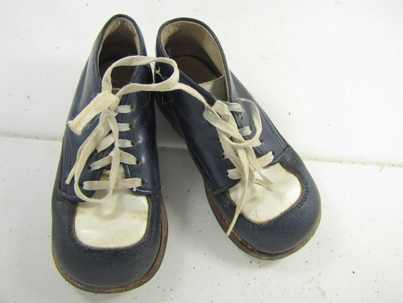 RESERVE FOR CHLOE vintage pair of children shoes