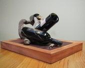 Artistic reclaimed wood wine bottle holder