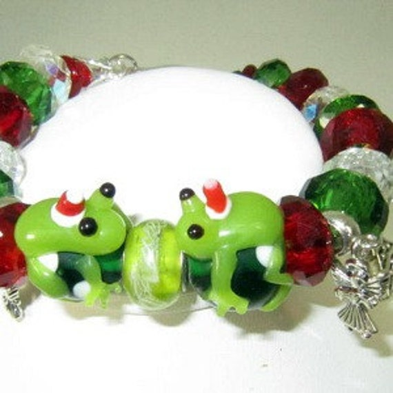 Dione Add-A-Bead Christmas bracelet in greens, reds  and froggies with Santa Hats.