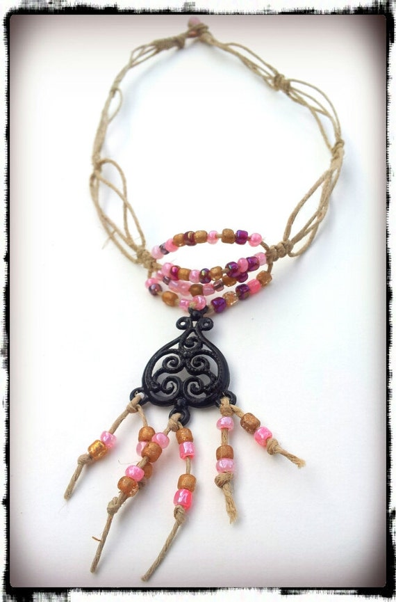 Hemp necklace featuring a black victorian heart pendant and shades of pink beads