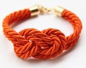 Arm candy - Orange Knot Bracelet - 24k gold plated