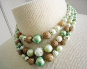 Vintage multi strand necklace / 60s faux pearl necklace / 60s green gold white iridescent bead necklace/ MAD MEN necklace