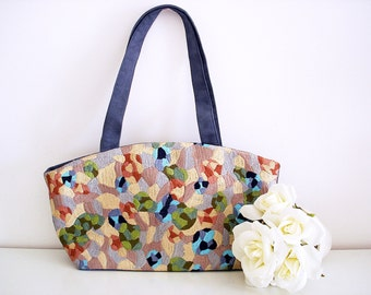Vintage 70s crewel embroidery handbag/ grey micro suede back/ multicolor abstract floral patterns/ blues greens pastels beige lavender
