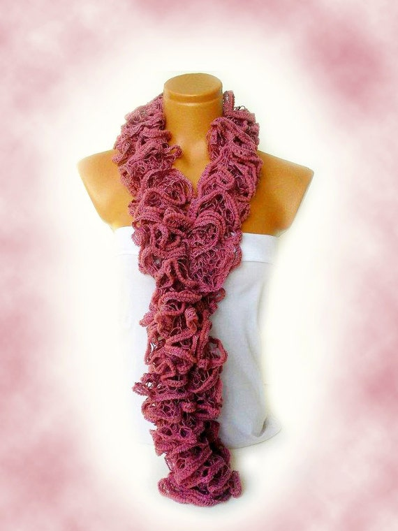 the scarf is knitted with pink soft yarn scarf