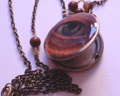 Art locket, evil eye protection locket, altered art, keepsake jewelry on antique bronze necklace with wire wrapped peruvian opals