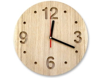 Wall clock made out of solid oak, ash or maple, minimalistic style