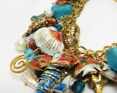 Cha cha bracelet. Sea life, shell and fish charms. Cloisonne enamel. White, aqua and coral. Gold chain. Feminine bBeach jewelry.