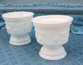 Two similar small milk glass vases, pots, cups, containers