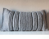 Grey knitted pillow