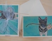 "Set of twelve 4"" x 5.5"" notecards with an original portrait by Vanessa Giddens.  Blank inside.  German Shepherd Dog and Magnolia Flower."