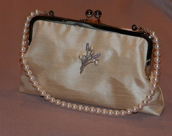 Champagne Shantung with pearl brooch and pearl handle