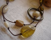 Earthtones 24 inch necklace - a mix of cream, green, tan, and brown