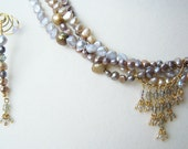Mystery pearl and gold necklace and earrings.