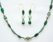 Erin necklace-bracelet and earrings in mixed green stones.