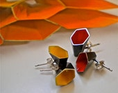 Hexagonal silver ear studs, colored with red enamel inside.