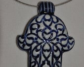 Mothers day gift: Ceramic pendant necklace with carved Hamsa hand and white and blue glaze