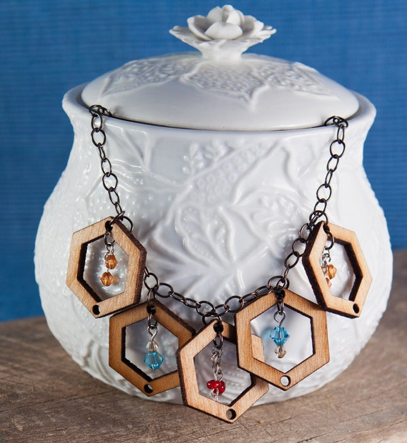 Laser cut wooden hexagons paired with recycled beads and gunmetal findings.