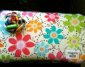 covered diaper wipe case with attachable changing pad.