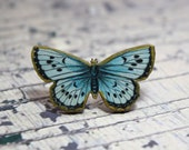Vintage print pale blue wooden butterfly ring