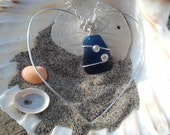 Sterling silver sun catcher with  blue sea glass